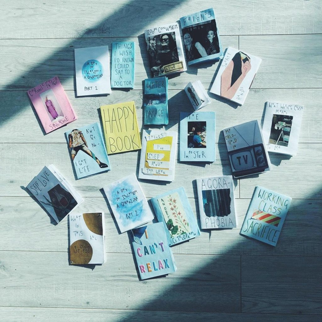 "A photograph of many zines scattered on the floor. Their titles include: ""happy book"", ""things I wish I'd known I could say to a doctor"", ""working class sacrifice"", ""things I've cried about this week"", ""self love"", ""I can't relax"", ""my childhood in TV'."