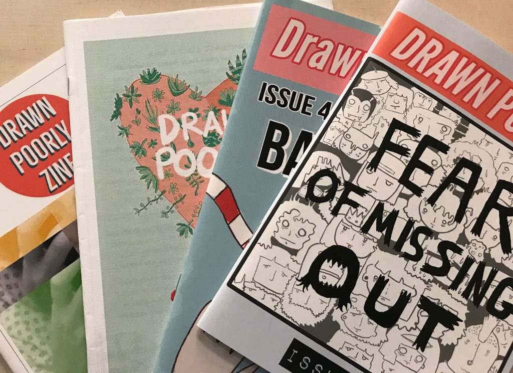 "4 issues of Drawn Poorly. The front visible issue says ""fear of missing out"" on the cover."
